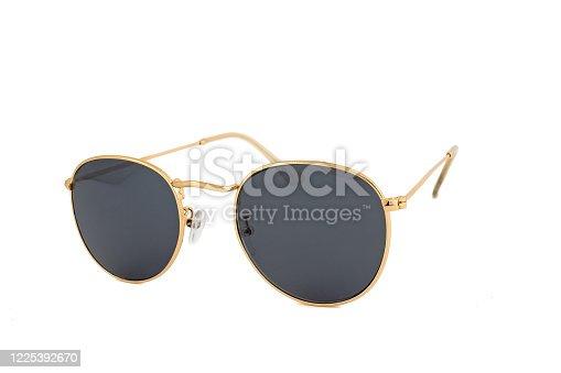 1047544590 istock photo Black Golden Frames Sunglasses Isolated on White Background 1225392670