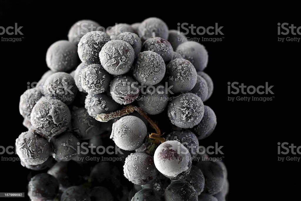 Black grapes frozen on the mirror royalty-free stock photo