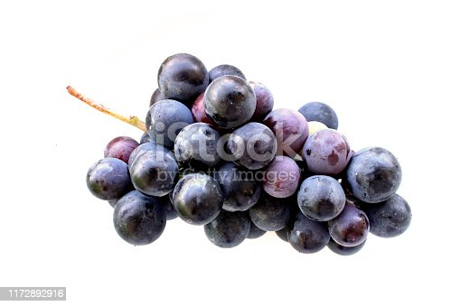 black grapes on white background