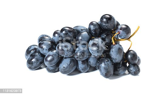 Black grapes with drop of water isolated on white background