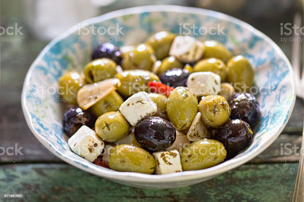 Black green olives with soft cheese stock photo