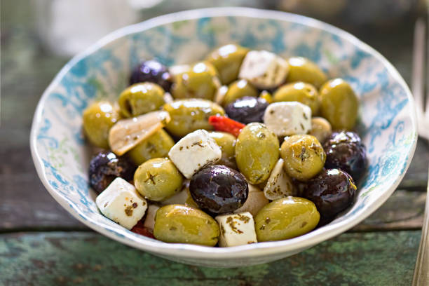 black green olives with soft cheese - pimento cheese stock photos and pictures