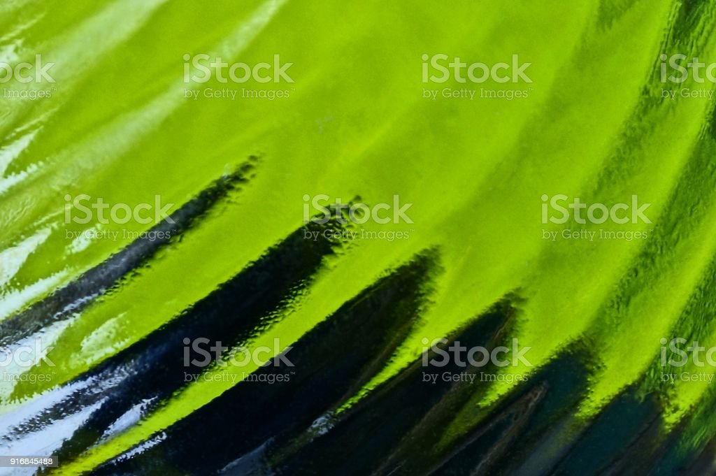black green texture of a hazy glass bottle stock photo