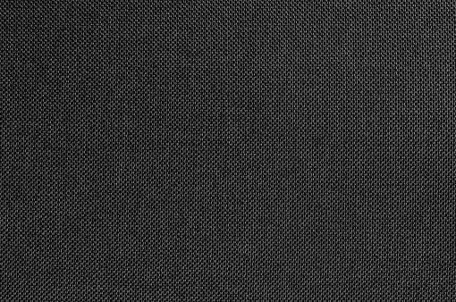 Black grey fabric texture for background and design art work with seamless pattern of natural textile.