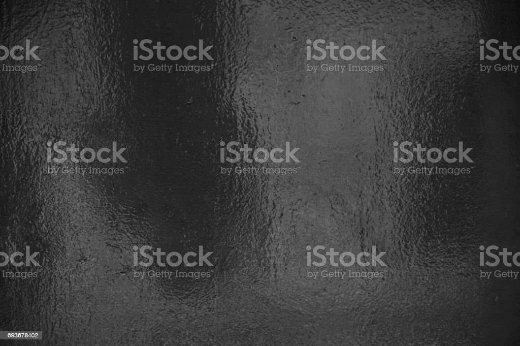 Black grey shiny foil background stock photo
