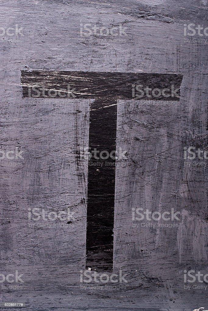 Black grunge alphabet. Letter T stock photo