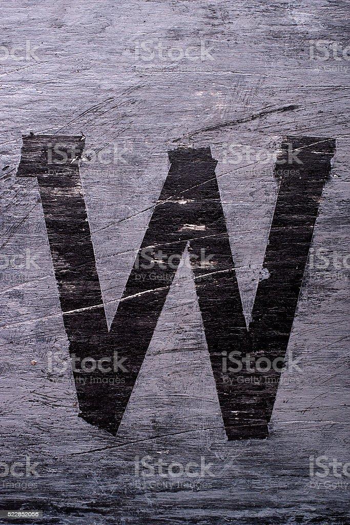 Black grunge alphabet. Letter W stock photo