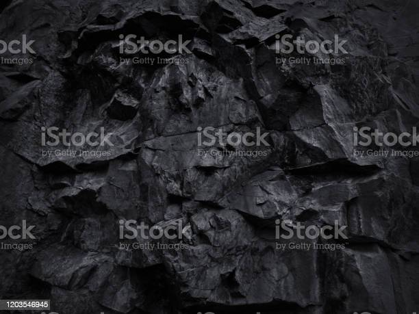 Photo of Black grunge background. Black and white background. Mountain texture close-up.