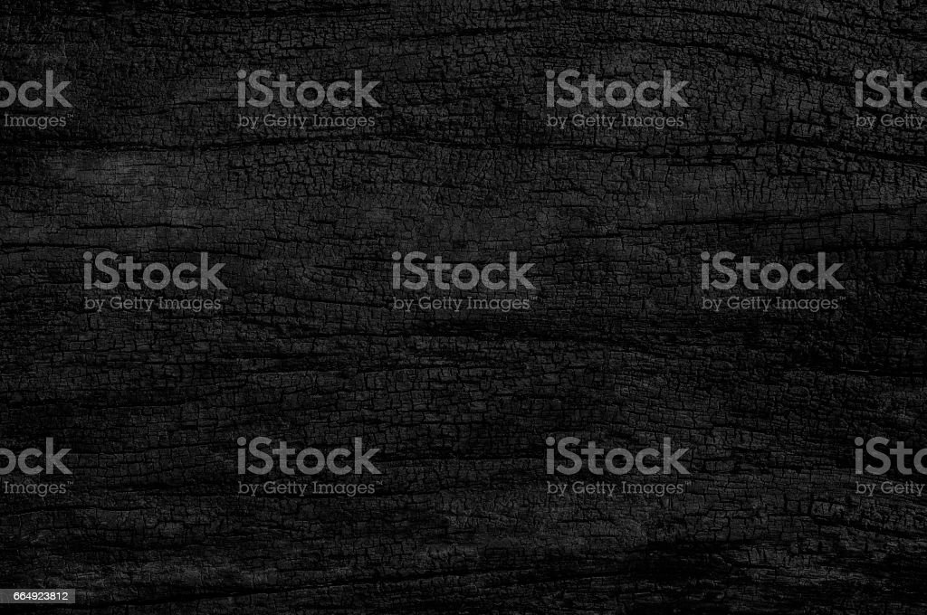 Black grunge background. Burned wood texture. stock photo