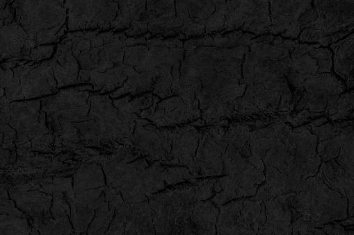 Black grunge background. Burned wood texture.