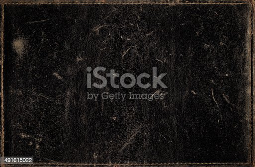 istock Black grunge background from distress leather texture with stitched frame 491615022
