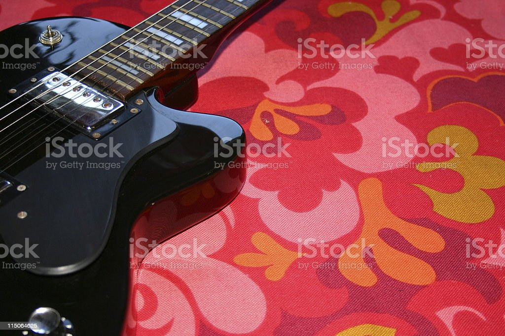 black guitar on retro stock photo