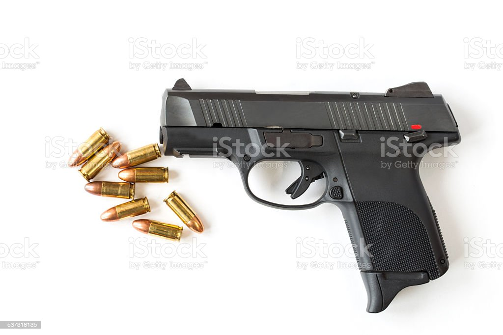 Black gun and 9mm bullets isolated a white background. stock photo