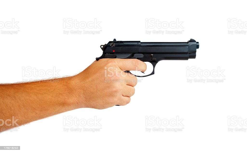 Black gun in a hand isolated on white background stock photo