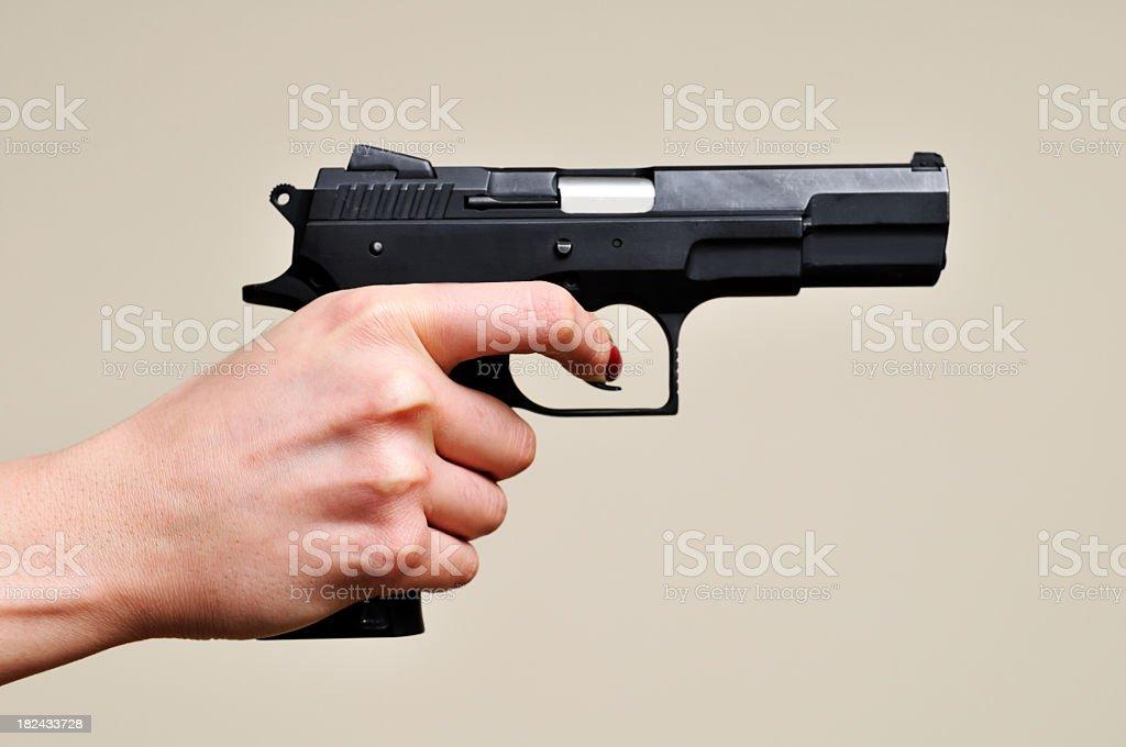 Black gun in a hand royalty-free stock photo