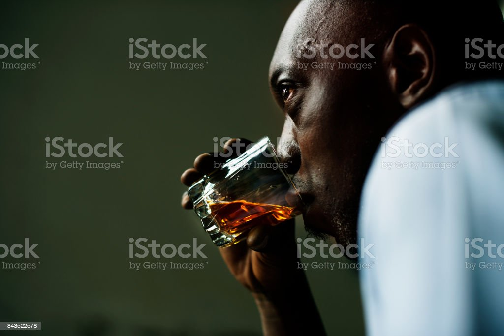 Black guy acoholic with stressing stock photo