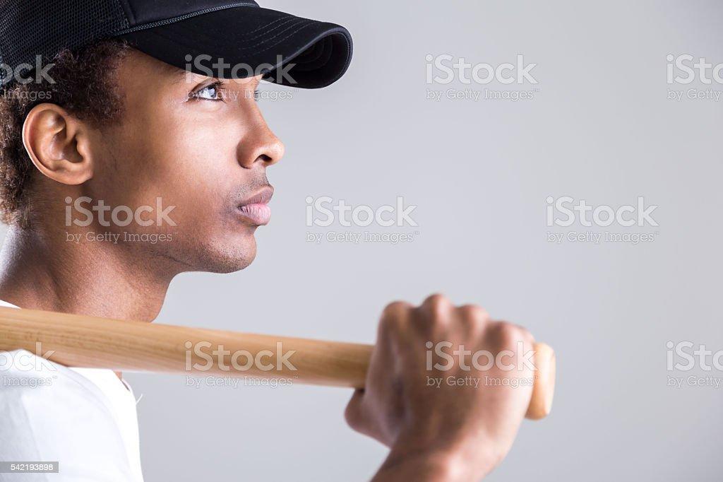 Black guy holding bat stock photo