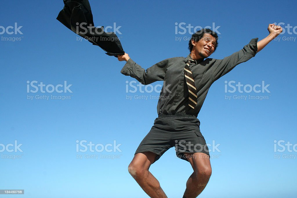 black guy jumping and smiling on a clean sky stock photo