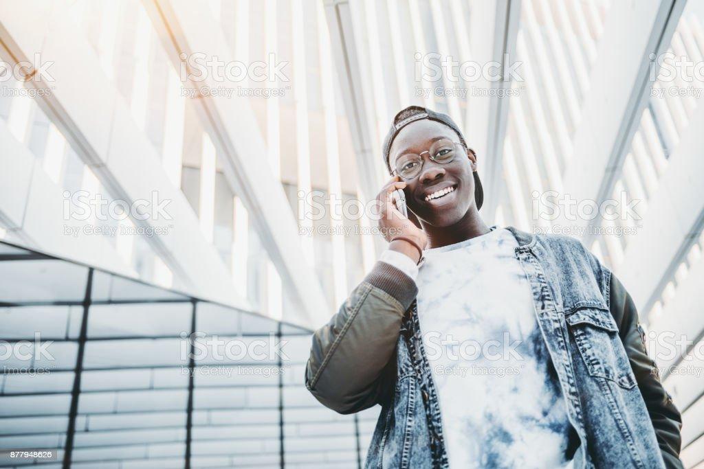 Black guy speaking on his smartphone stock photo