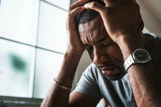 Black guy stressing and headache stock photo