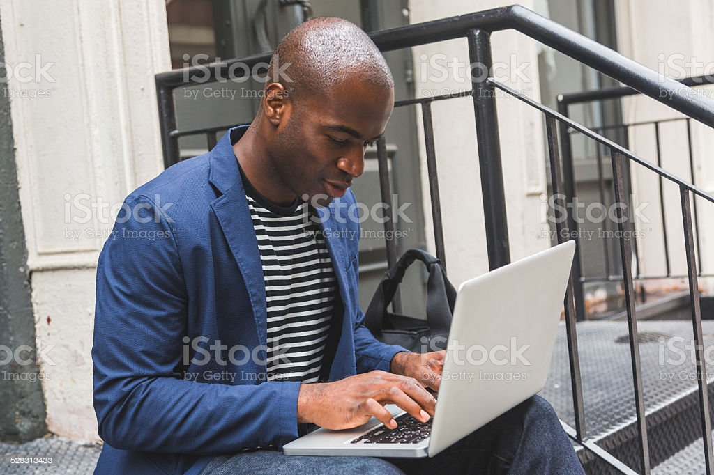 Black Guy Using Notebook in New York stock photo