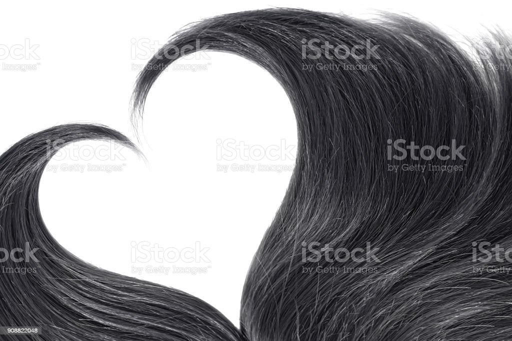 Black hair in shape of heart on white stock photo