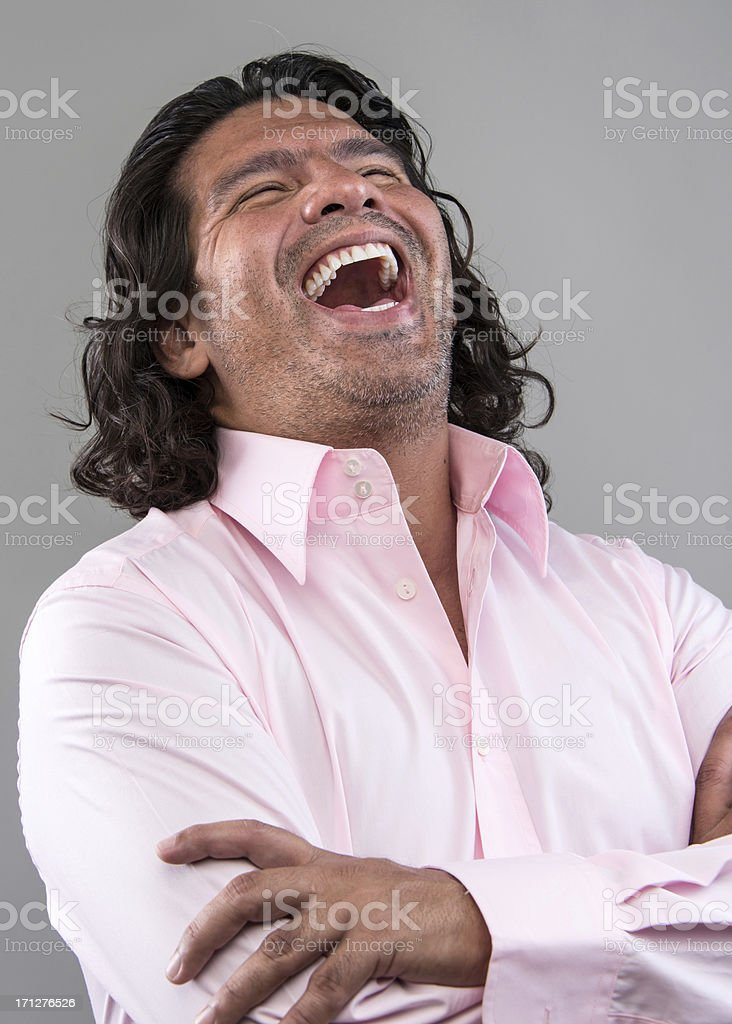 Black haired Hispanic male throws back his head and laughs out loud. royalty-free stock photo