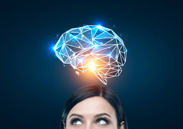 black haired woman and a blue brain hologram - genius stock photos and pictures