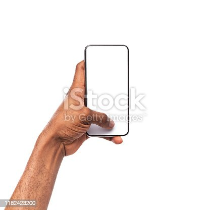 950613878 istock photo Black hand holding and touching blank smartphone screen with thumb 1182423200