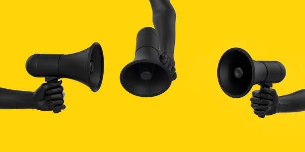 Black hand holding Megaphone on yellow background in different poses. Isolated loudspeaker announcement and Sale creative banner concept. 3d rendering. Black hand holding Megaphone on yellow background in different poses. Isolated loudspeaker announcement and Sale creative banner concept. 3d rendering. verbaasd stock pictures, royalty-free photos & images