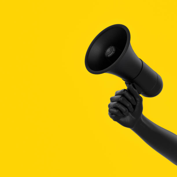 black hand holding megaphone on yellow background. isolated loudspeaker announcement and sale creative banner concept. 3d rendering. - megafono foto e immagini stock