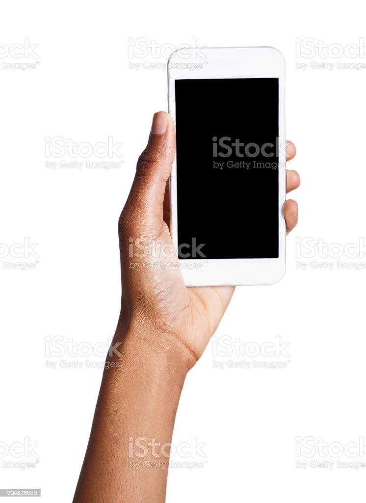 Black hand holding mobile smart phone with blank screen stock photo