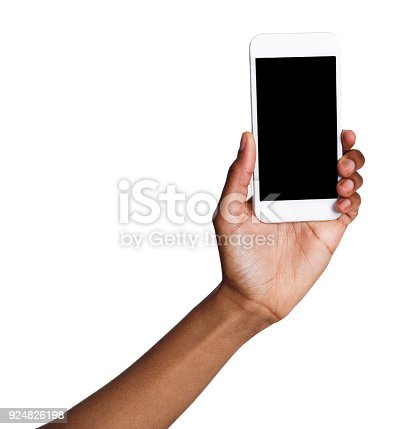 1132512759istockphoto Black hand holding mobile smart phone with blank screen 924826198