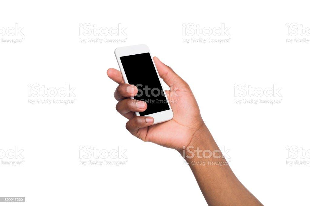 Black hand holding smartphone on isolated white background stock photo