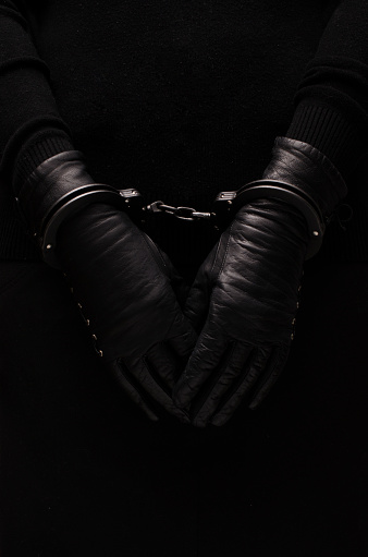 Black Handcuffs Leather Black Gloves Concept Stock Photo - Download Image Now