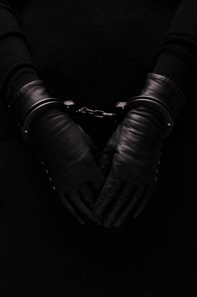 Black handcuffs leather black gloves, concept Black handcuffs leather black gloves, concept arrestment stock pictures, royalty-free photos & images