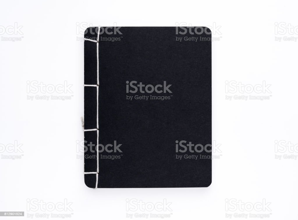 Black handmade notebook on white background stock photo