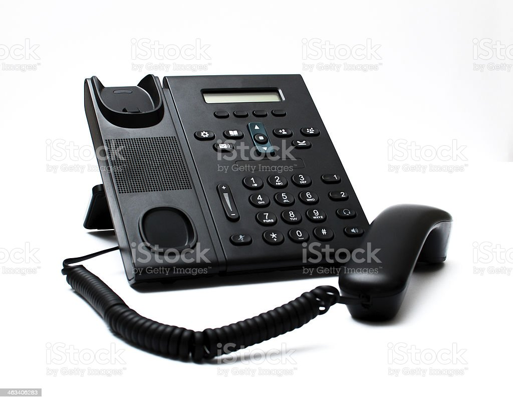 Black handset and a phone stock photo