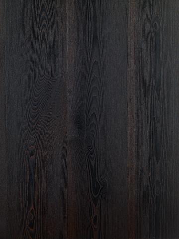 Black hardwood floor background. Ash tree wood texture. Wood parquet. Dark ash  wood floor. Ash tree Grand Canyon wood type.