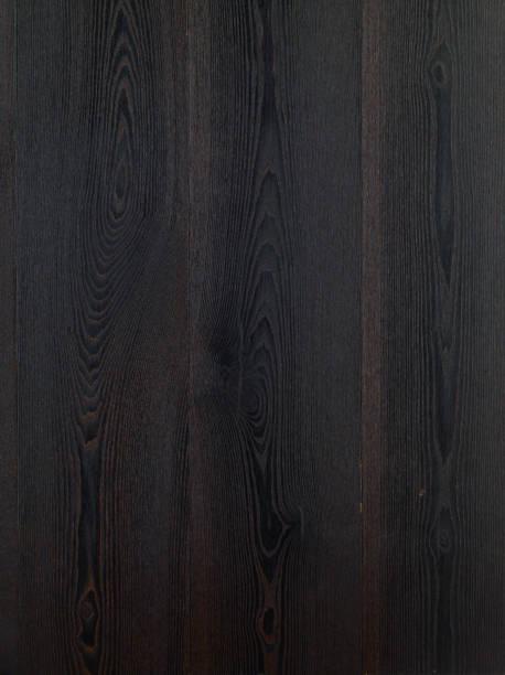 Black hardwood floor background. Ash tree wood texture. Wood parquet. Dark ash tree wood floor. Ash tree Grand Canyon wood type. stock photo