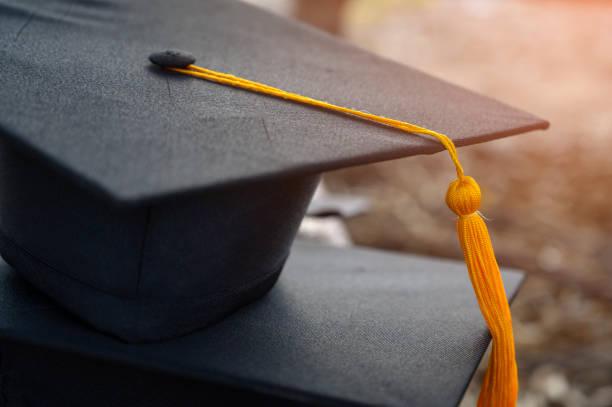 black hat of university graduates - graduation cap stock pictures, royalty-free photos & images