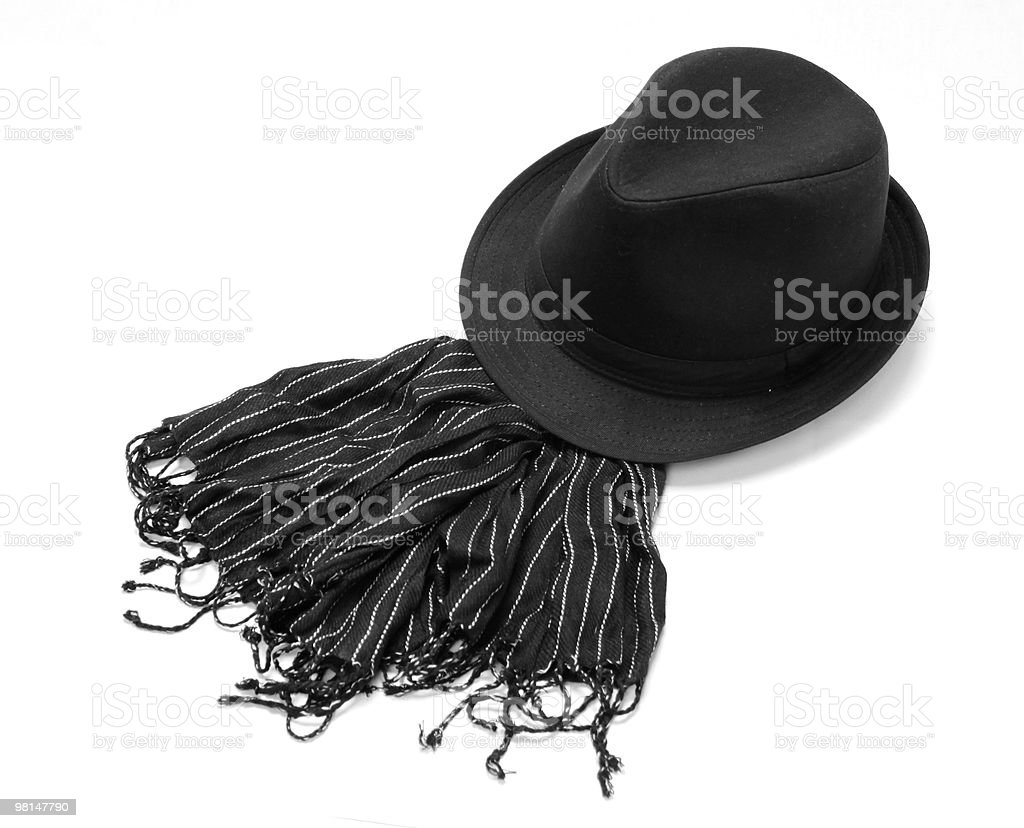 Black hat with striped muffler royalty-free stock photo