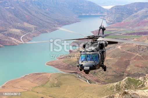 istock UH-60 Black Hawk Military Helicopter flying 1303343612