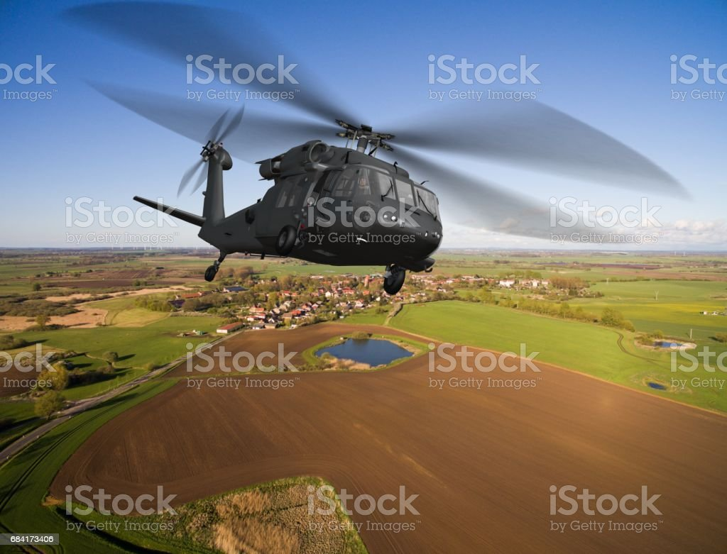 Black Hawk Uh-60 military Helicopter in flight - aerial view close up royalty-free stock photo