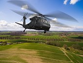 Black Hawk Uh-60 military Helicopter in flight - aerial view close up