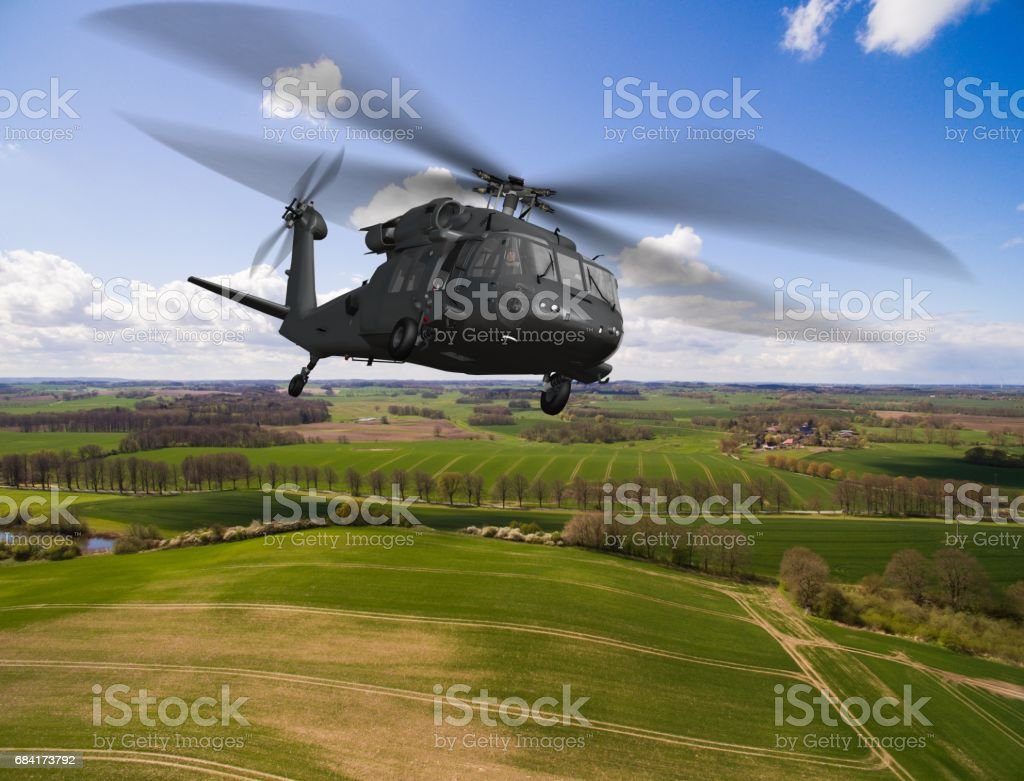 Black Hawk Uh-60 military Helicopter in flight - aerial view close up stock photo