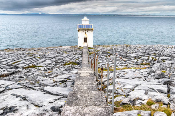 black head lighthouse - the burren stock pictures, royalty-free photos & images