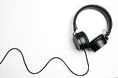 istock Black headphones isolated on the white background 1134520463