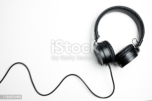 Black electronic headphones isolated on the white background