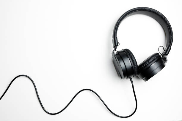 Black headphones isolated on the white background Black electronic headphones isolated on the white background dj stock pictures, royalty-free photos & images